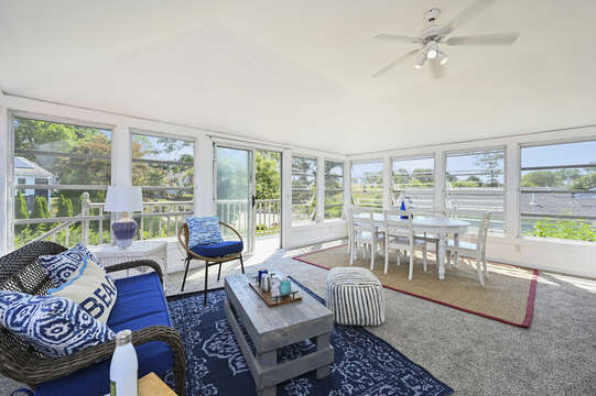 Large bright sun room with sitting area and dining table for 6 - 113 South Street Harwich Port - Cape Cod - New England Vacation Rentals