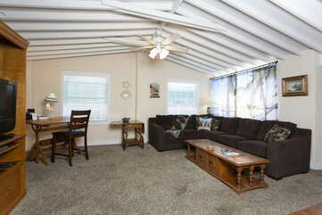 The family living room has a comfortable sectional, perfect for movie night.