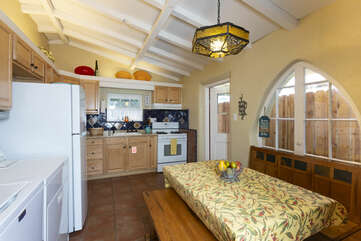 This quaint kitchen has a dining area and washer/dryer