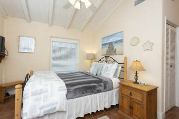 This tranquil master bedroom has a Queen size bed.