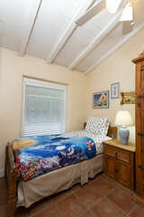 One single twin bed and a bunkbed in the second bedroom.