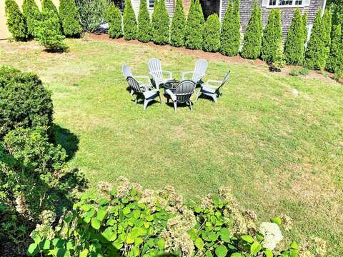 Overview of backyard with fire pit-113 South Street Harwich Port - Cape Cod - New England Vacation Rentals