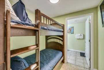 Bunk beds and entrance into 3rd bathroom.
