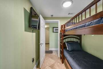 Bunk beds with mounted TV on wall