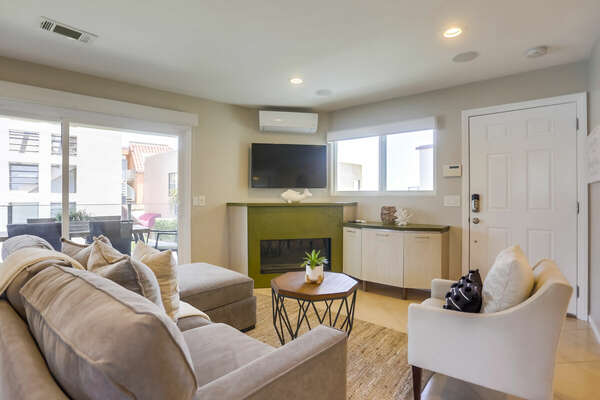 Living Room w/ Queen Sleeper Sofa + Fireplace - 2nd Floor