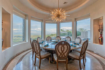 Formal dining area with sensational golf and mountain views.