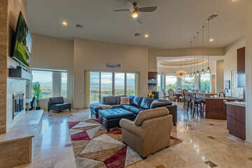 A truly GREAT room with comfortable seating, a large TV and alluring golf, mountain and canyon views.
