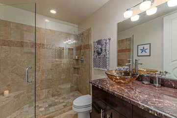 Bathroom 4 on the lower level includes a walk-in shower and is shared by Bedrooms 5 and 6.
