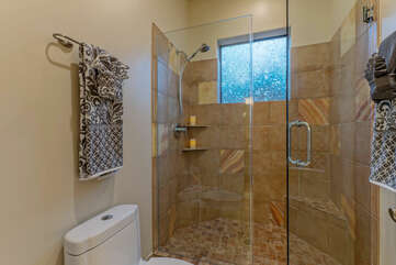 Bathroom 4 features a walk-in shower with a door to separate the vanity sinks from the commode and shower.