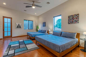 Beautiful Bedroom 4, also on the main level, has 2 king beds, TV and ceiling fan.
