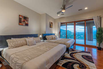 Bedroom 6 with patio access and a sensational view has 2 kings beds and shares Bathroom 4 with Bedroom 5.