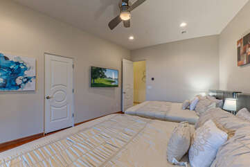 Bedroom 6 on the lower level includes 2 kings beds, TV and ceiling fan.