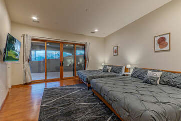 Bedroom 5 with 2 king beds is on the lower level and has patio access.