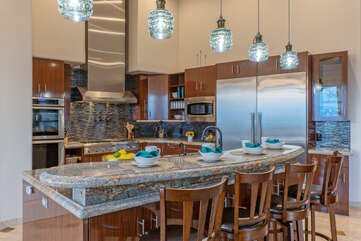 Contemporary kitchen includes a double oven, subzero fridge, sink with pot filler and an under counter wine fridge.