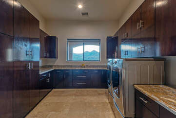 Even the large, well stocked laundry room offers an impressive view of the golf course and mountains.