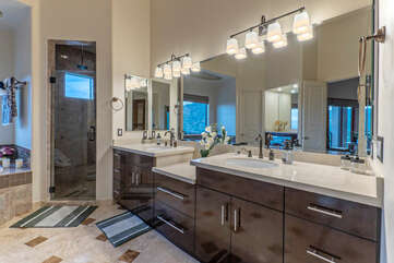 A walk-in shower, jetted tub and dual vanity sinks are appealing features of the primary bath.
