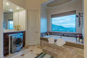 Toss your laundry into the extra washing machine in the primary suite bath.