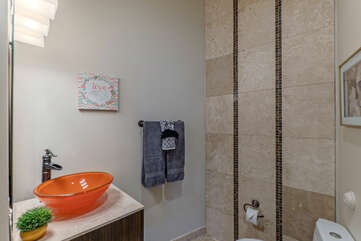 Powder room on the main level is for guests and visitors.
