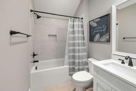 Upstairs bathroom has double sinks and room for both upstairs Master and kids room. If you overflow - send a kid to shower in the pool house.