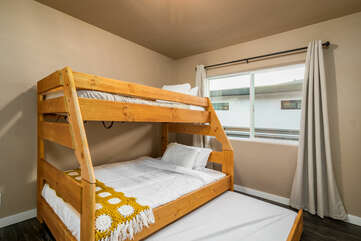 Bunk Room with a Twin over Full Bunk Beds and a Twin Trundle