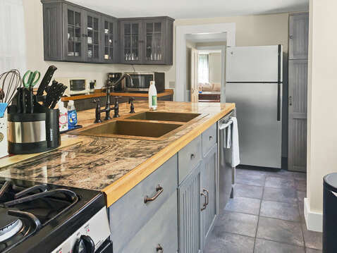 Bronze hammered sink is a unique centerpiece in this functional kitchen - 98 West Road Orleans Cape Cod New England Vacation Rentals