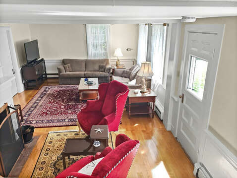View of living area from staircase to second floor - 98 West Road Orleans Cape Cod New England Vacation Rentals