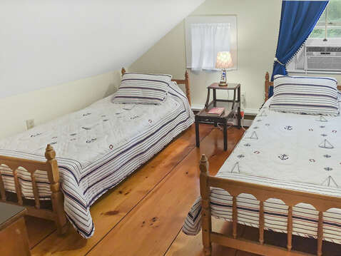 Bedroom 3 with two twin beds and A/C unit - 98 West Road Orleans Cape Cod New England Vacation Rentals