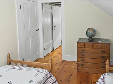 Wide plank wood floors lead back to Bedroom 2 in front and Bathroom 2 to the right - 98 West Road Orleans Cape Cod New England Vacation Rentals