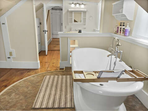 Soaking tub, full mirror and bathroom area fill this large room - 98 West Road Orleans Cape Cod New England Vacation Rentals