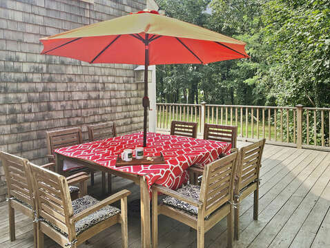 Outdoor dining at the large teak dining area - 98 West Road Orleans Cape Cod New England Vacation Rentals
