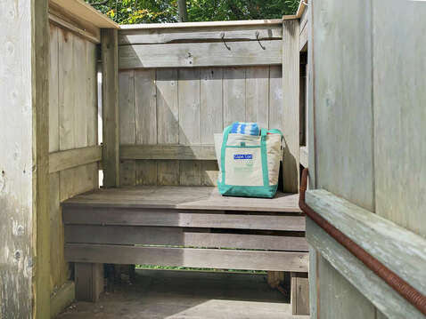 A place to sit in the outdoor shower - 98 West Road Orleans Cape Cod New England Vacation Rentals