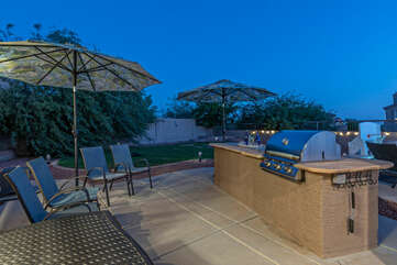 Your outdoor chef will appreciate the built-in grill and seating with an appealing view.