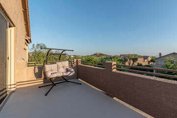 Private balcony off primary suite offers both city and mountain views.