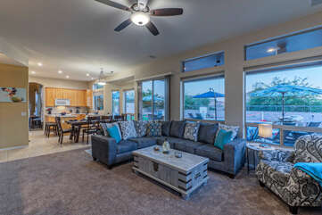 Great room is spacious and has large windows which permit natural light to illuminate all corners.
