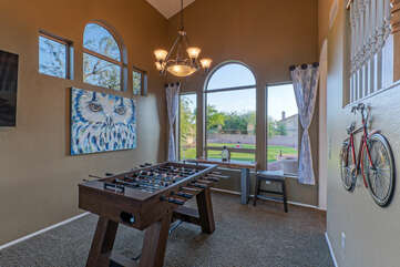 Enjoy foosball competition with a view of the backyard oasis.