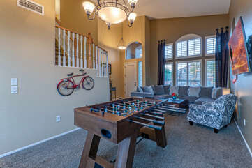 Imagine the foosball fun in front room with cozy seating for the cheering squad.
