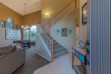 Entrance way showcases the staircase to second floor and open floor plan.