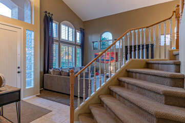 Staircase leads to 4 bedrooms and 2 bathrooms on second floor.