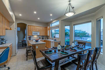 Kitchen opens into a dining area for enjoying home cooked meals or take-out from local restaurants.