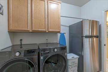 The well stocked laundry room includes a beverage fridge to keep all your favorites chilled.