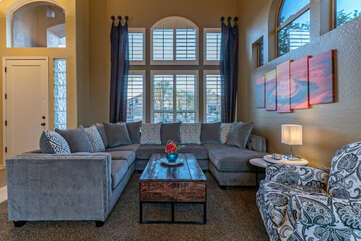 Front living room has plush seating for stretching out to read a good book or chatting with friends.