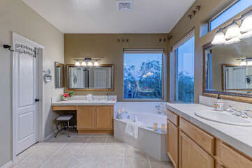 Wow to the dual vanities and luxurious garden tub in the primary suite bath.