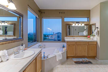 Space in primary suite bath allows two to simultaneously primp for an exciting night on the town.