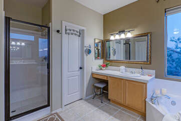 Primary suite has both a separate walk-in shower and a garden tub.