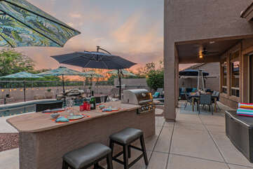 Comfy seating and a built-in gas grill will please your outdoor chef.