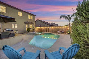 Enjoy the large pool and backyard, or take in some sun with one of the two lounge chairs.