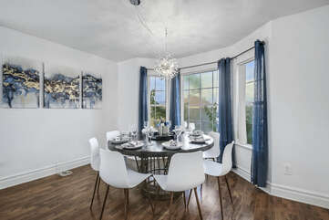 The casual dining room features a dining table with seating for eight.
