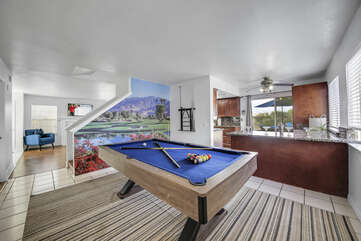The Game Room features a pool table with a beautiful Palm Springs area mural.