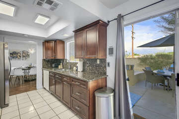 The kitchen is conveniently located near the patio dinning table for easy access.