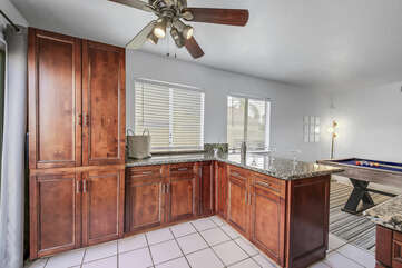 The bar top area between the kitchen and game room allows for a fun area to gather.